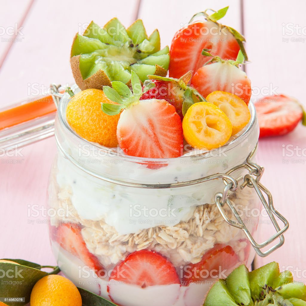 Porridge with fruits and yogurt stock photo