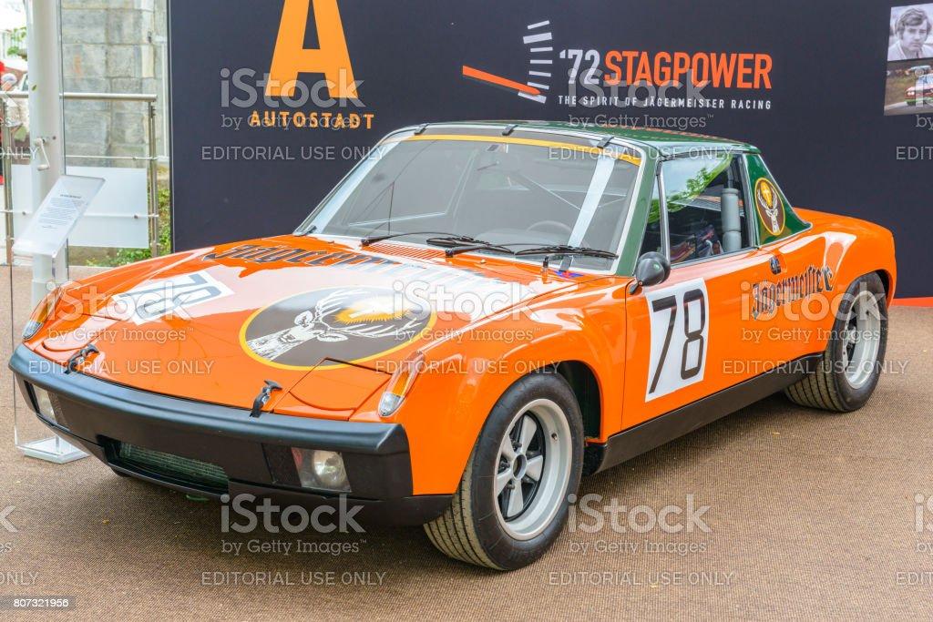 Porsche 914 classic Jagermeister racing car.in birght orange parked...