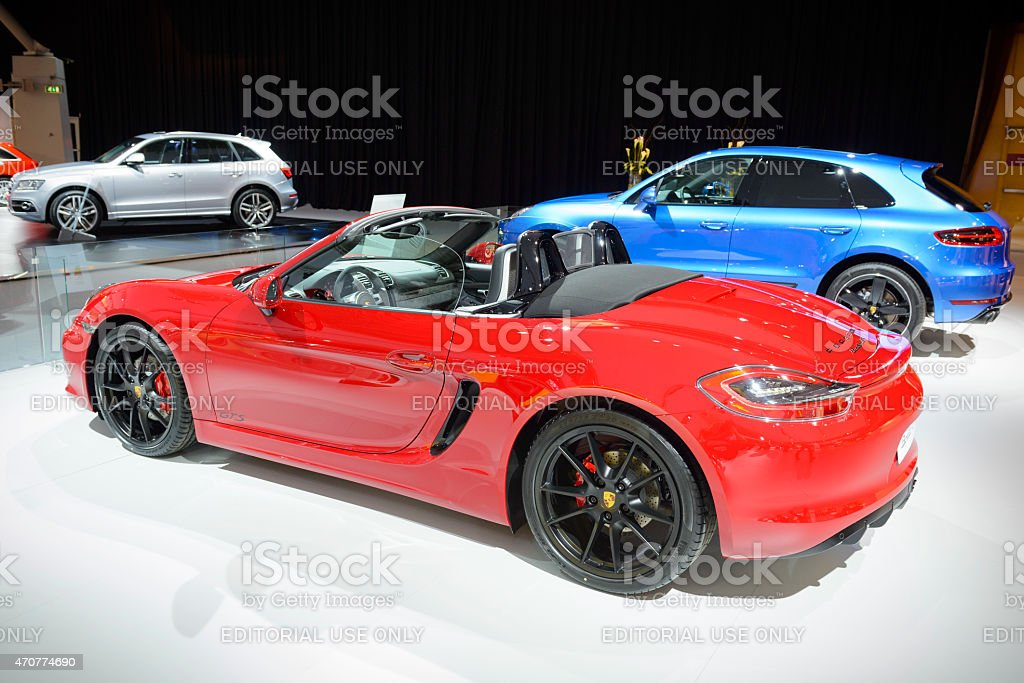 Porsche Boxster GTS roadster and Porsche Macan crossover SUV stock photo