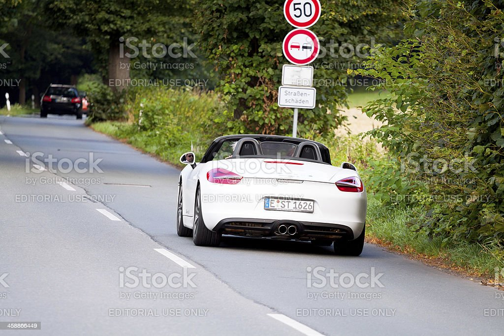 Porsche Boxster on road stock photo