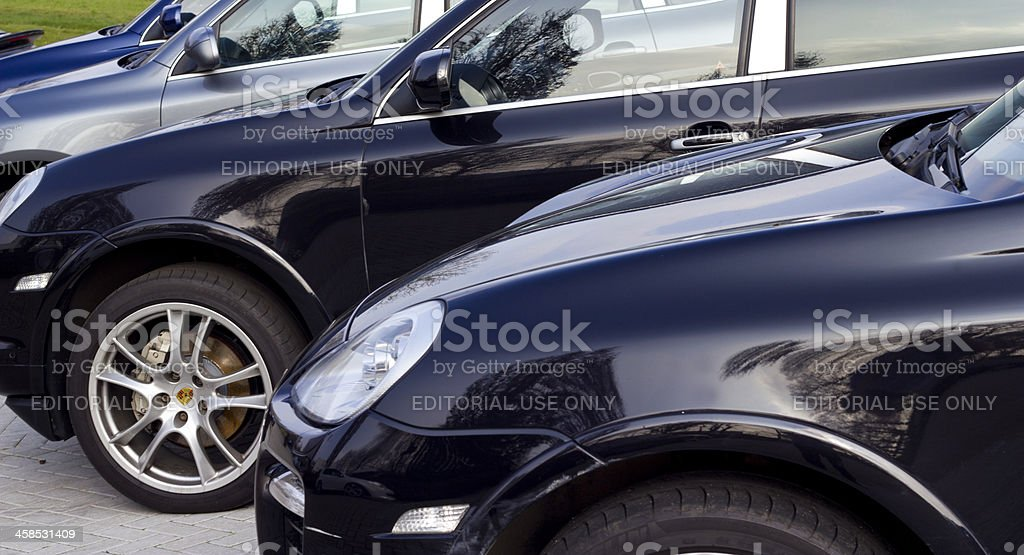 Porsche Cayenne SUV cars line up at a dealership stock photo