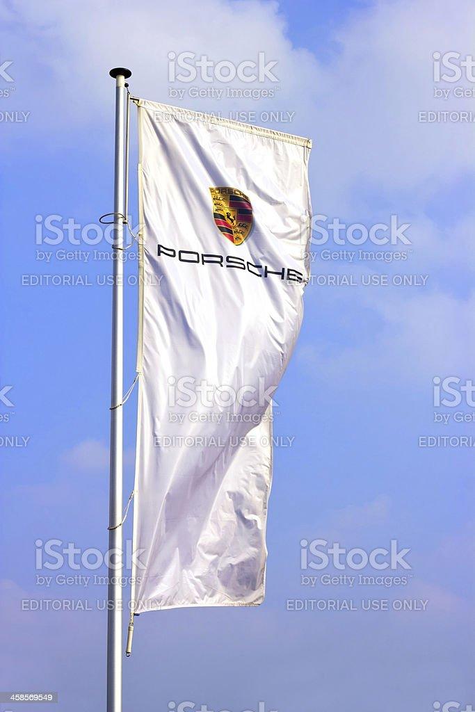 Porsche sports car producer logo on a flag stock photo