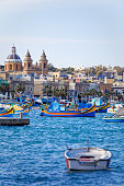 Port and Luzzu in Marsaxlokk, Malta