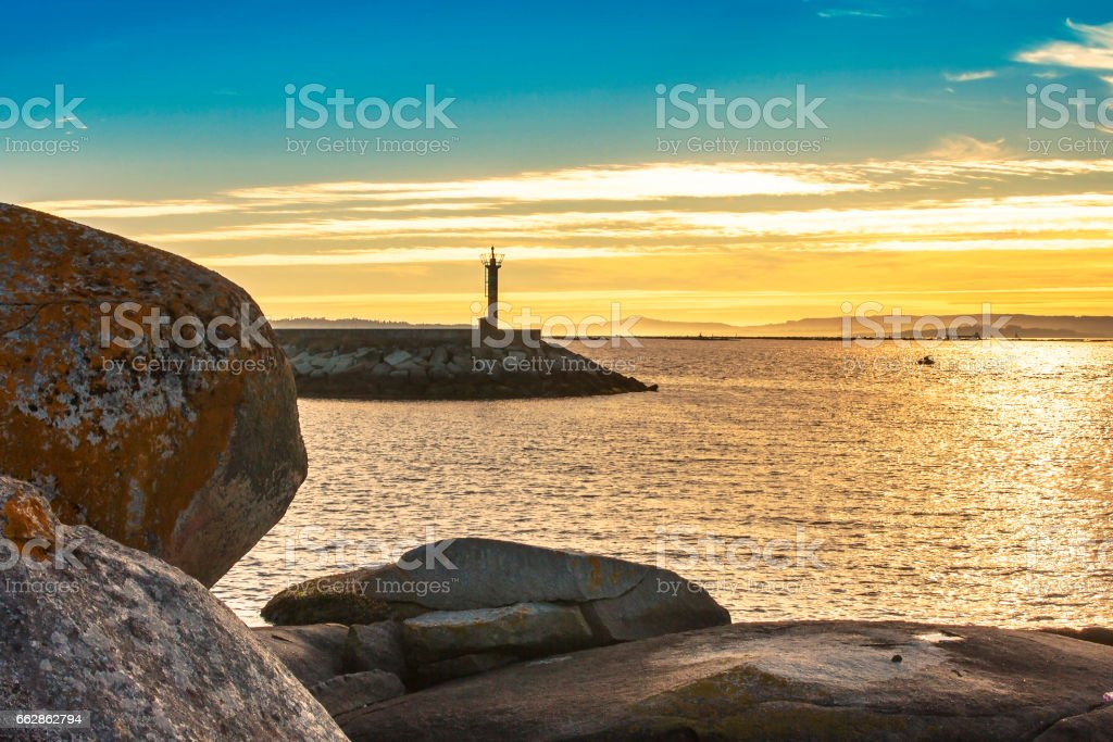 Port beacon at sunset stock photo