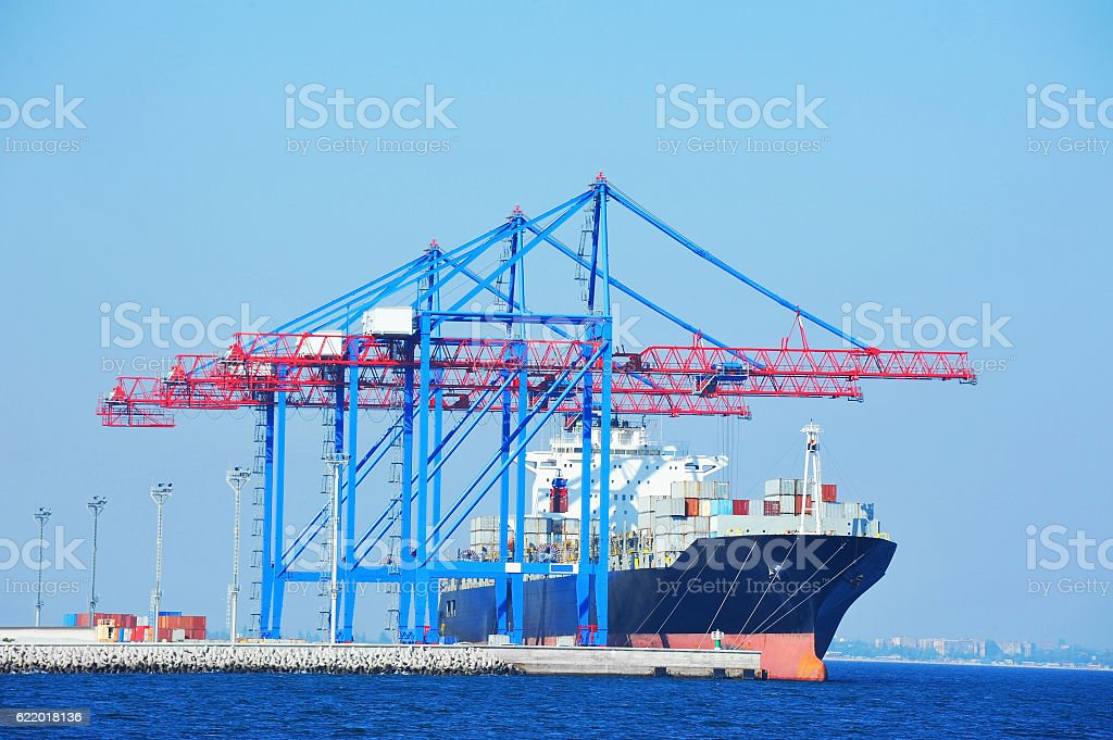 Port cargo crane, ship and container stock photo