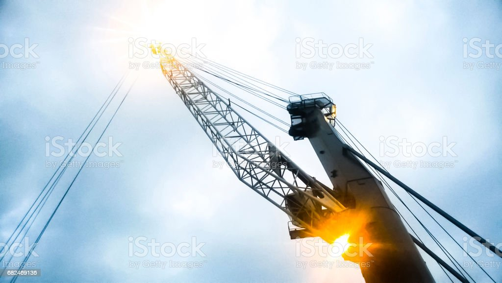 Port cranes against the sky. Cargo industrial port stock photo