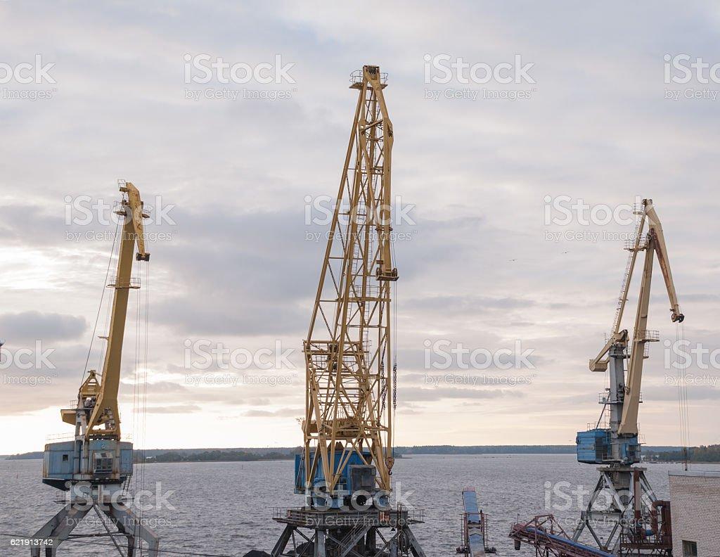 Port cranes at the port of loading platform. stock photo