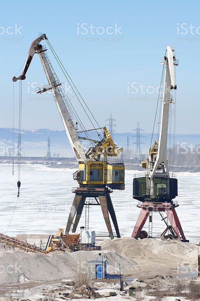 Port cranes at winter stock photo
