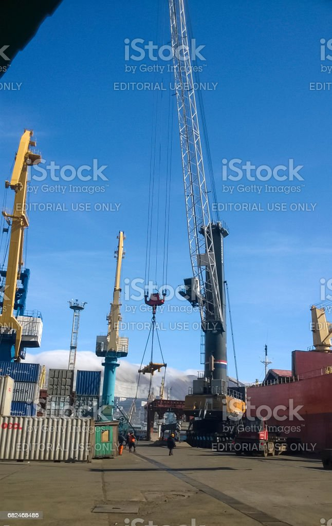 Port cranes. Industrial port. Cargo docks and lifts stock photo