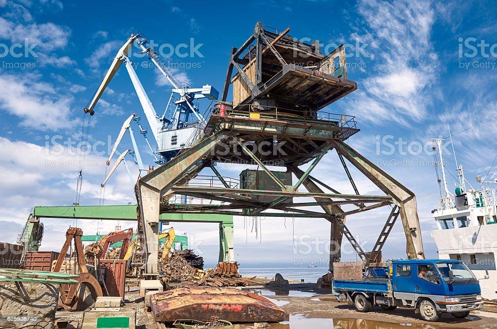 Port cranes, scrap-metal dock car ship, cloudy clear blue sky stock photo