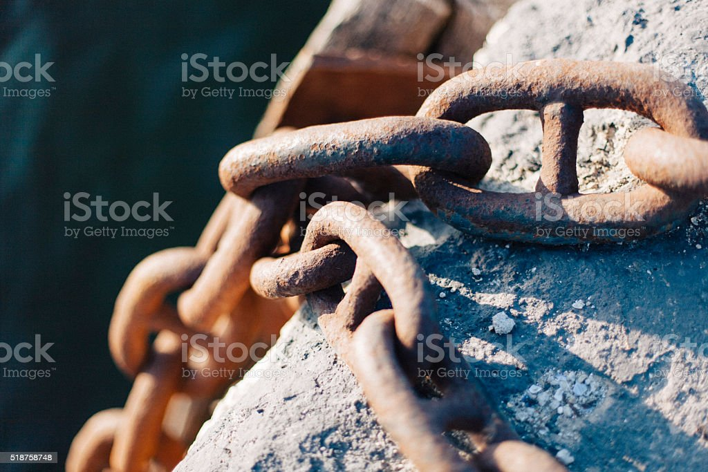 Port fender chains in rust stock photo