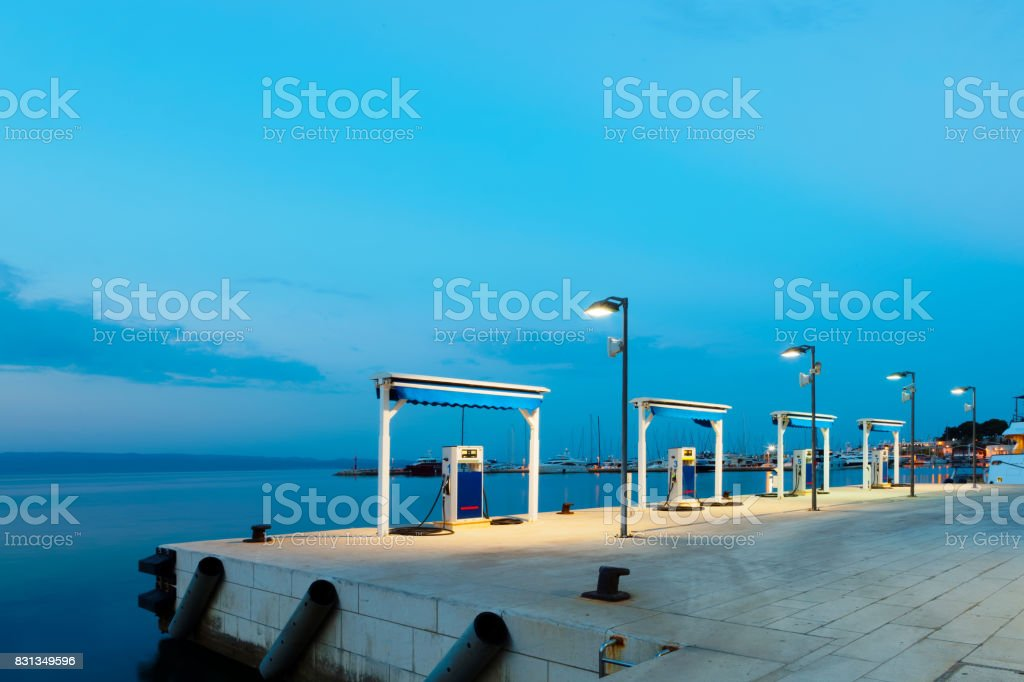Port gas station at night ready to tank boats stock photo