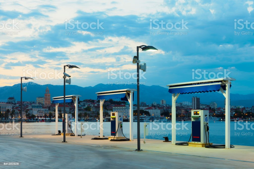 Port gas station at sunrise ready to refill boat's tanks stock photo