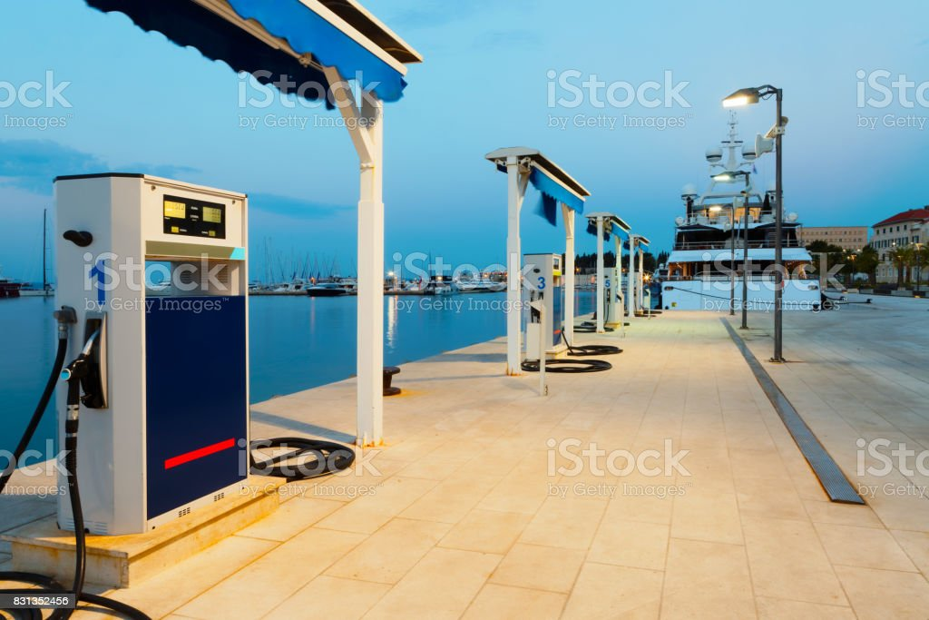 Port gas station in the morning ready to refill boat's tanks stock photo