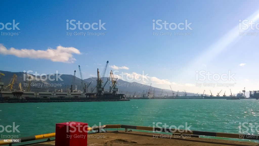 Port landscape. View of the industrial port. The sea, port crane stock photo