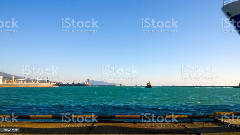 Port landscape. View of the industrial port. The sea, port cranes and ships stock photo