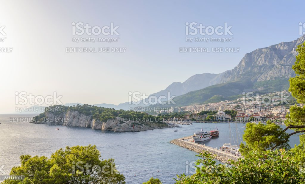 Port of Makarska, and views of the city in the evening stock photo