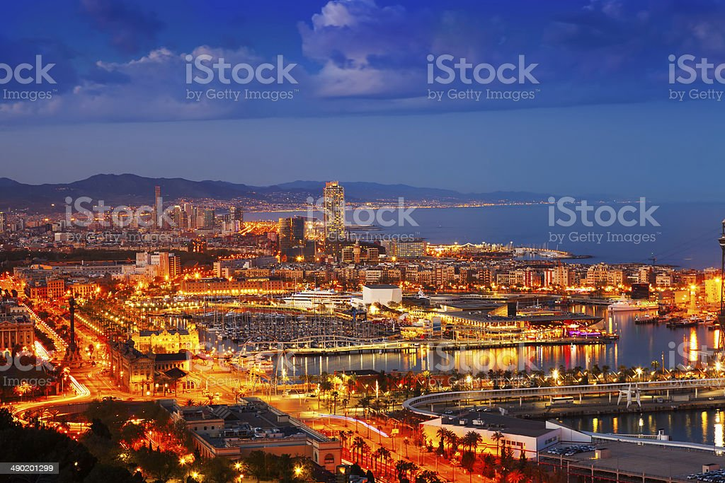 Port Vell and cityspace in Barcelona during evening stock photo