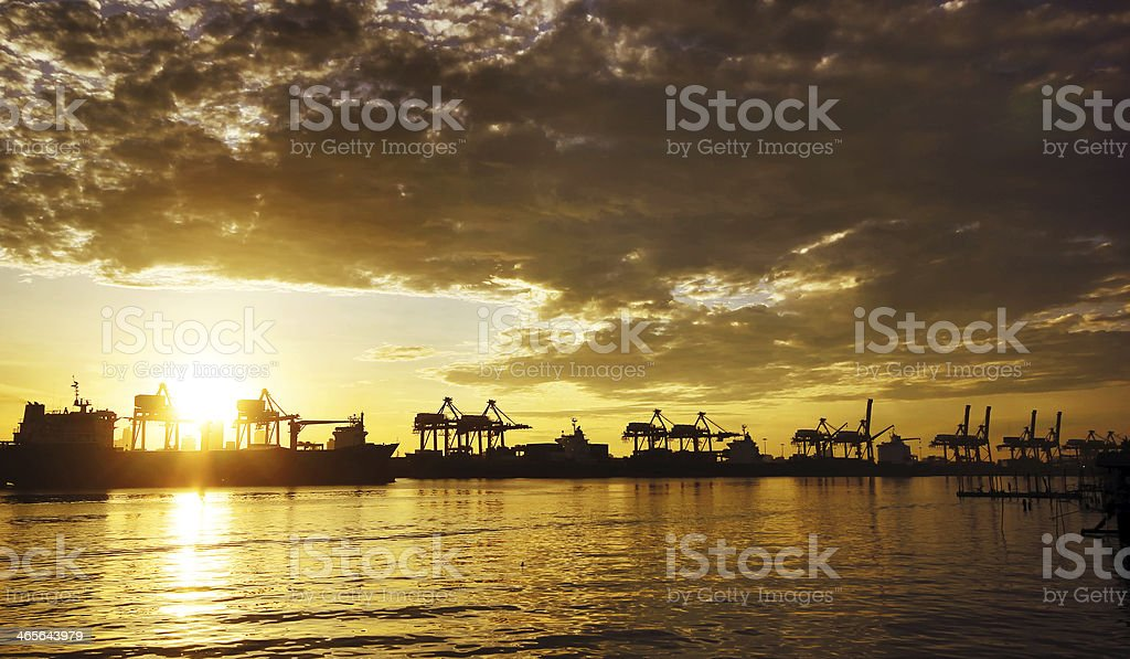 port warehouse with container cargo and crane bridge royalty-free stock photo