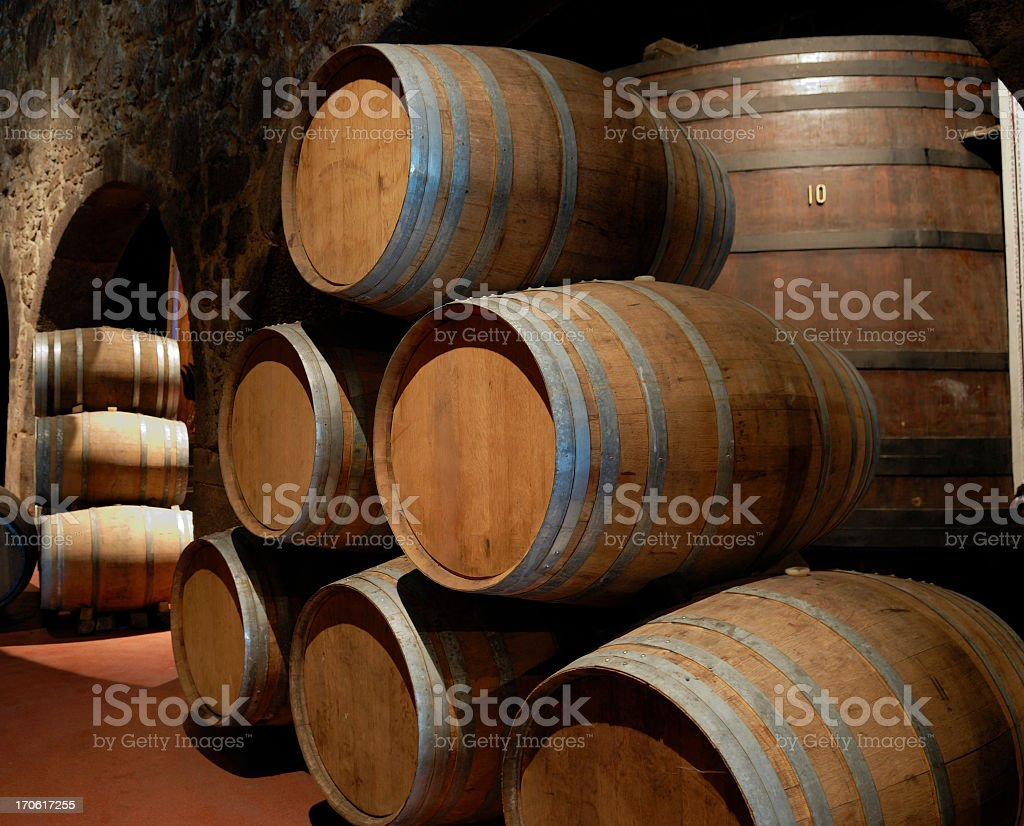 Port wine cellar with many stacked wooden barrels royalty-free stock photo