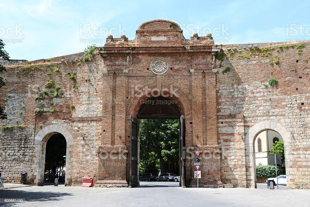Porta Camollia is a city gate in Siena, Tuscany Italy stock photo
