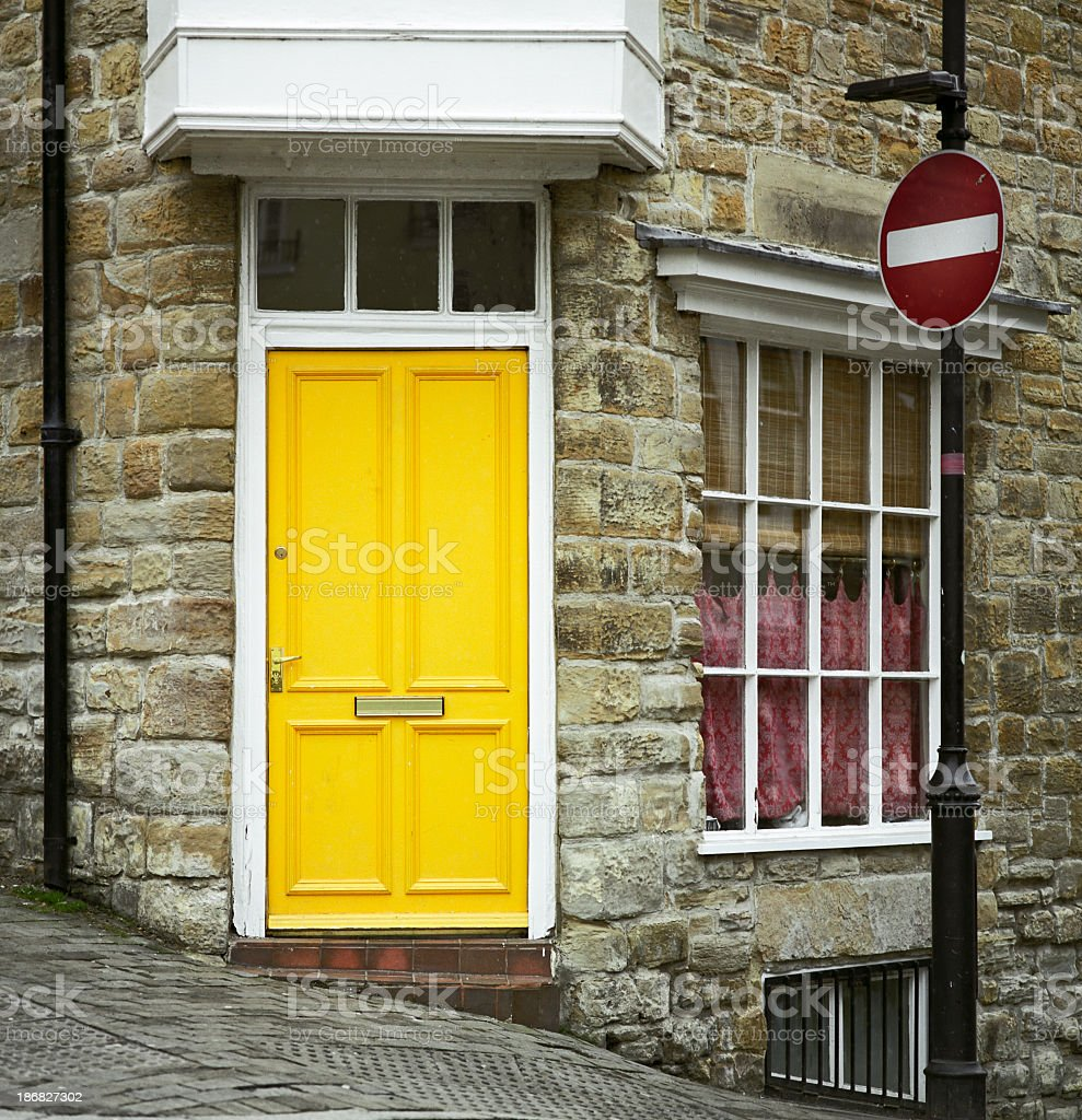 Porta gialla - Yellow door in English residential architecture royalty-free stock photo