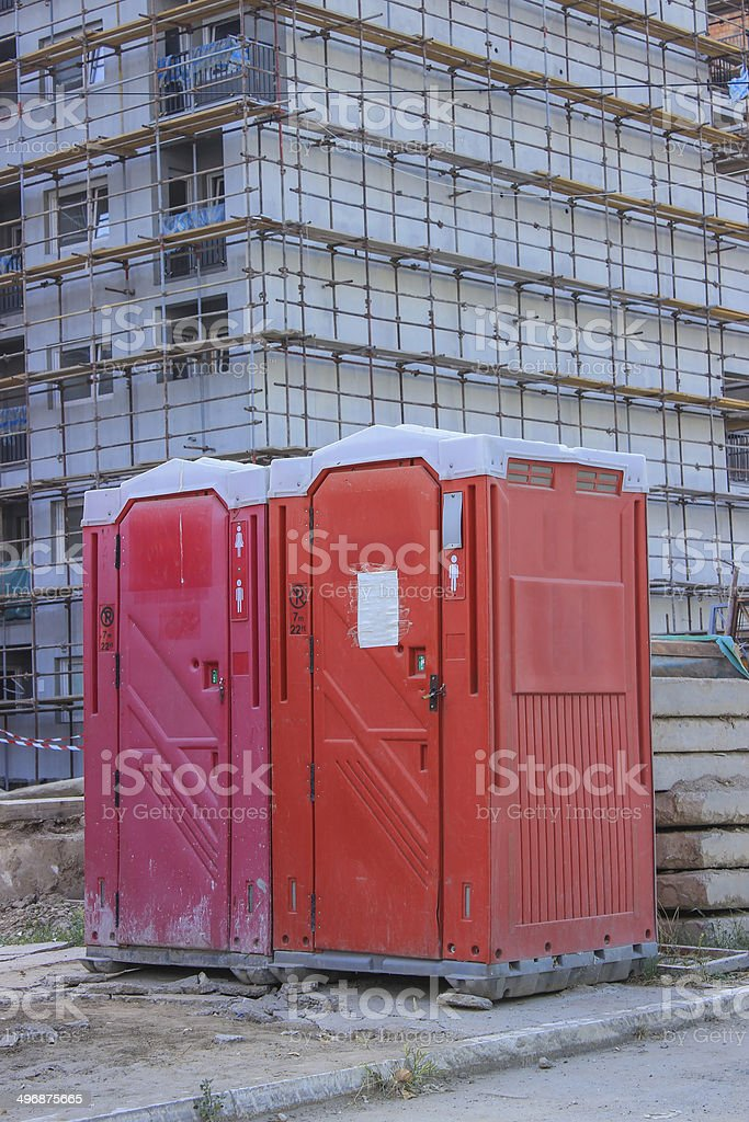 Porta Potty at construction site stock photo