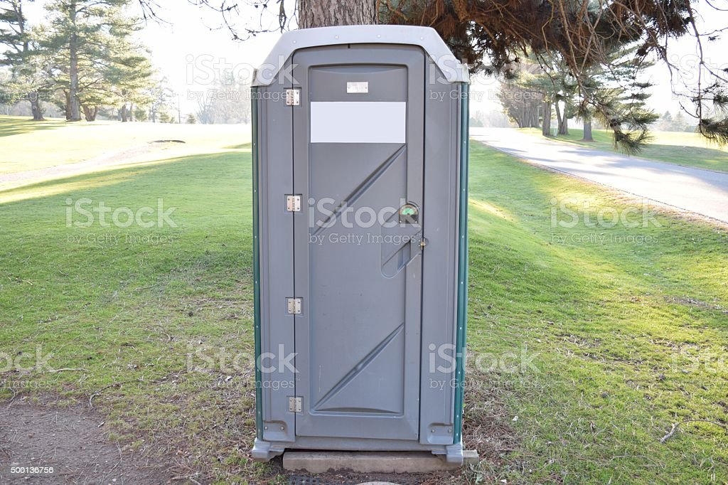 Porta Potty Green And Grey At Golf Course Under Tree stock photo