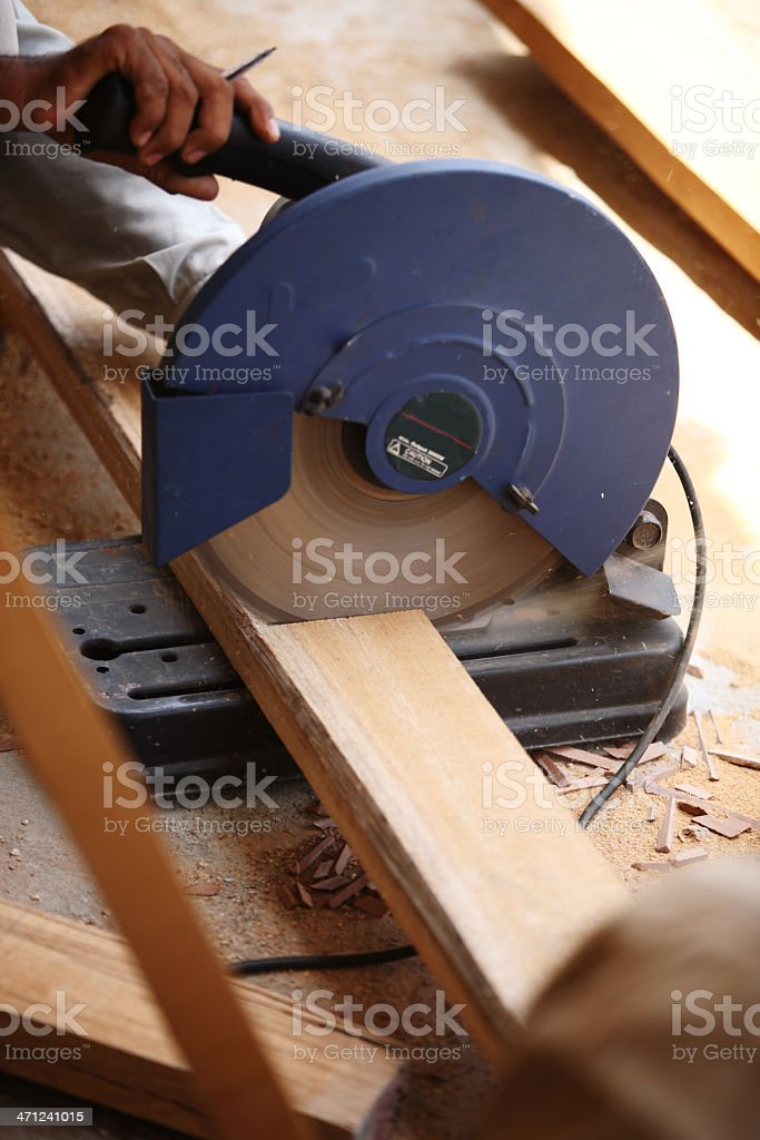 Portable Circular Saw Teak Wood Plank royalty-free stock photo