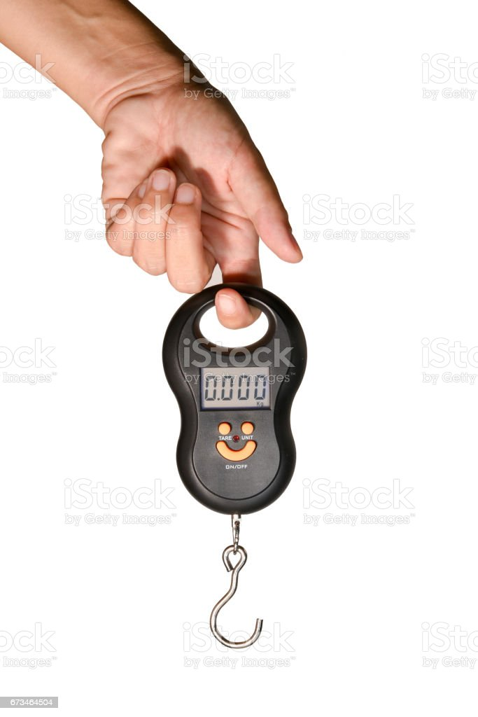 Portable Electronic Scale on hand stock photo