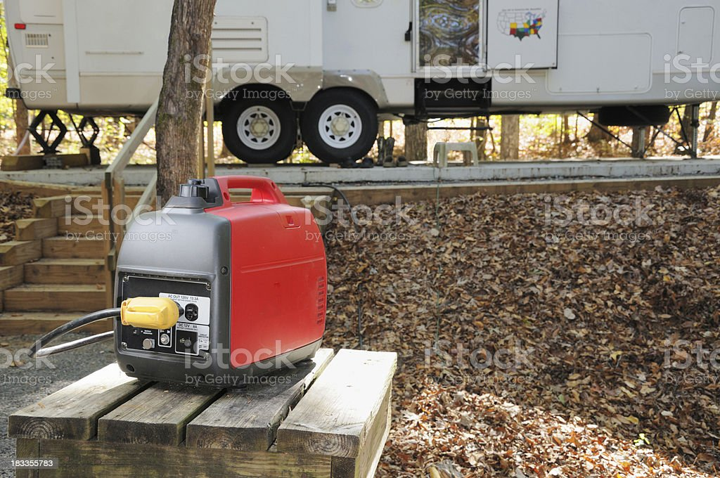 Portable generator with rv trailer stock photo