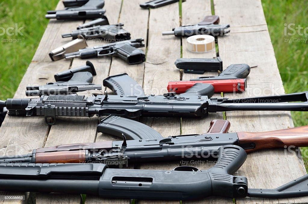 Portable guns on the table stock photo