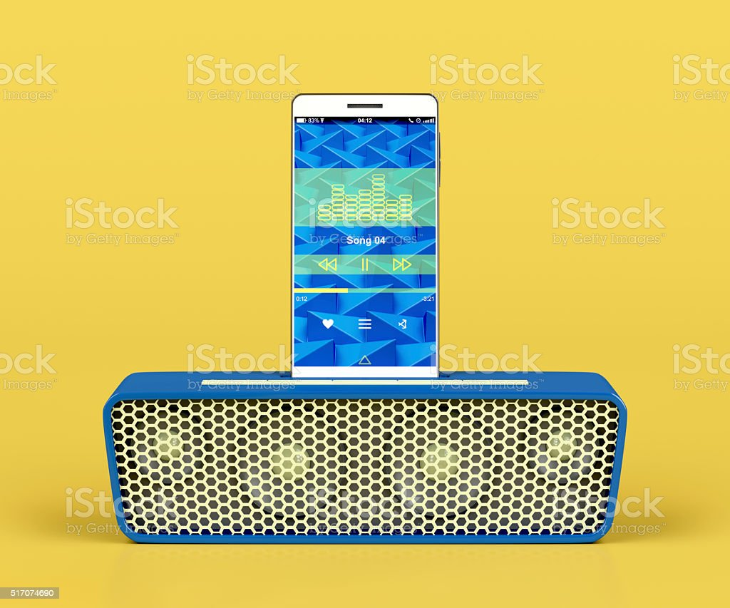 Portable speaker and smartphone stock photo