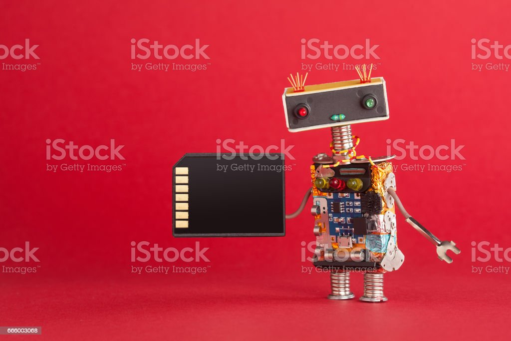 Portable storage device memory card concept. Abstract robot system administrator with electronic computing chip circuit on red background. Macro view copy space stock photo