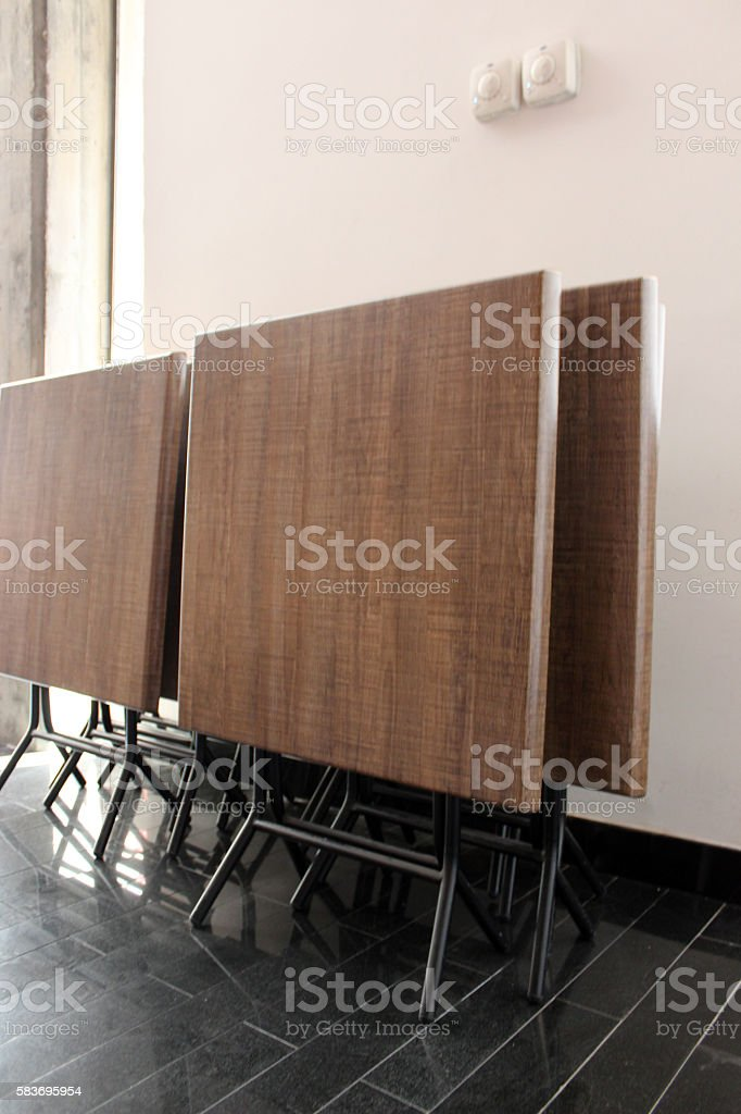 Portable tables in a corner stock photo