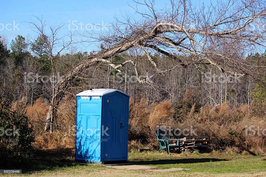 Portable Toilet In a Wooded Clearing stock photo