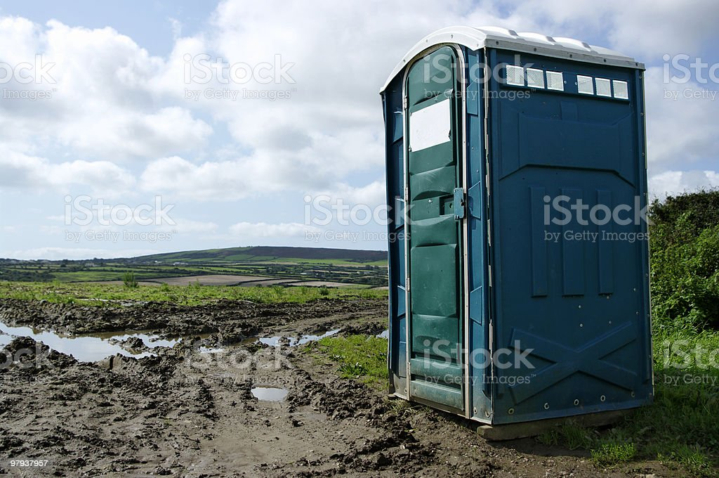 Portable Toilet In Muddy Field With View stock photo
