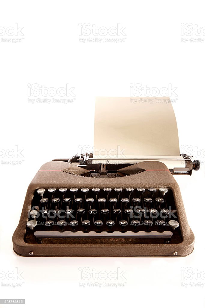 Portable typewriter and paper stock photo