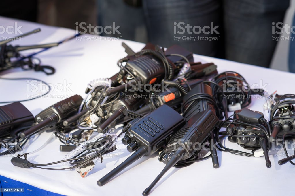 Portable walkie talkies on table stock photo