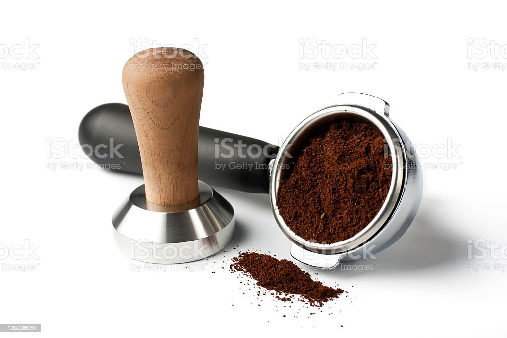 portafilter with tamper and ground coffee royalty-free stock photo