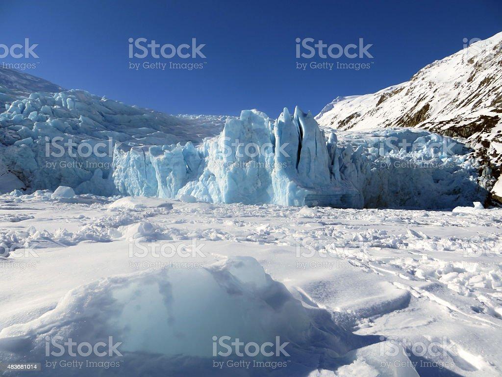 Portage Glacier Iceberg on Snow Covered Lake Landscape stock photo