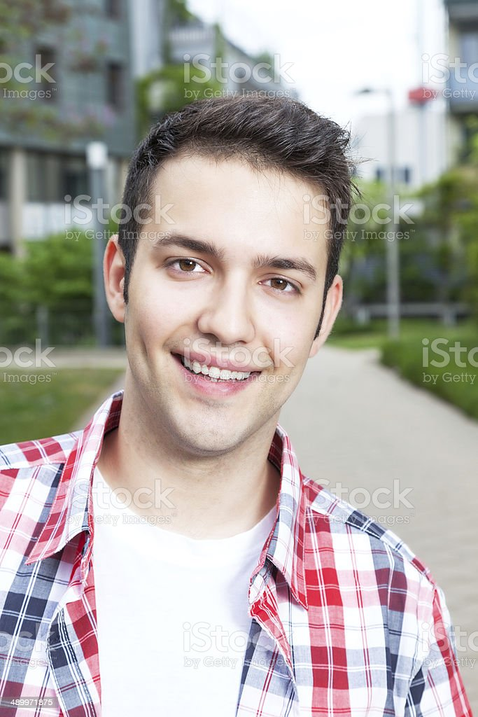 Portait of a laughing student with checked shirt stock photo