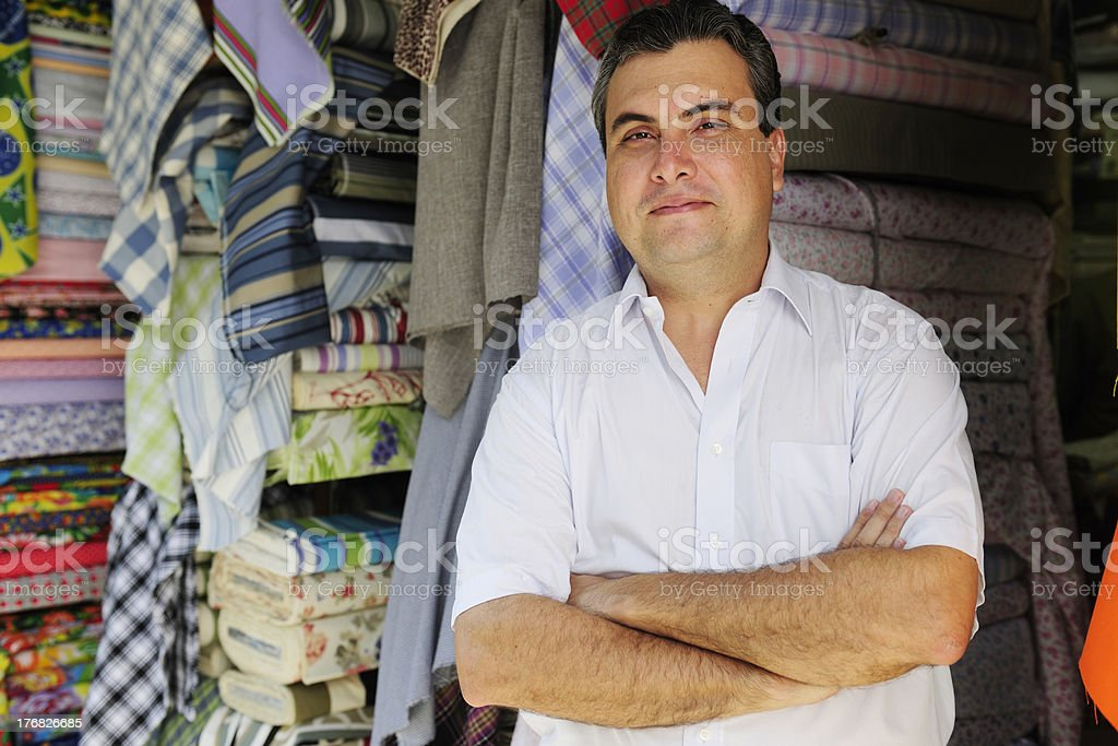 portait of a retail store owner stock photo