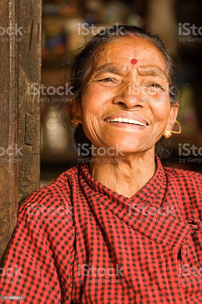Portait of happy Nepali woman in Bhaktapur near Kathmandu stock photo