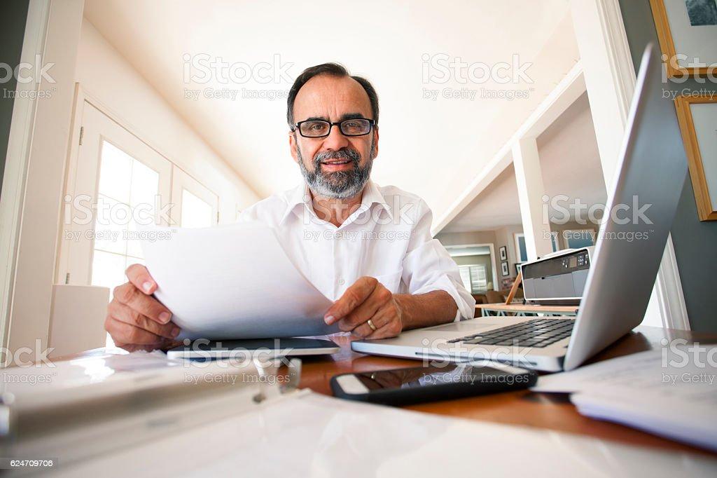 Portait Of Hispanic Man Working From Home stock photo