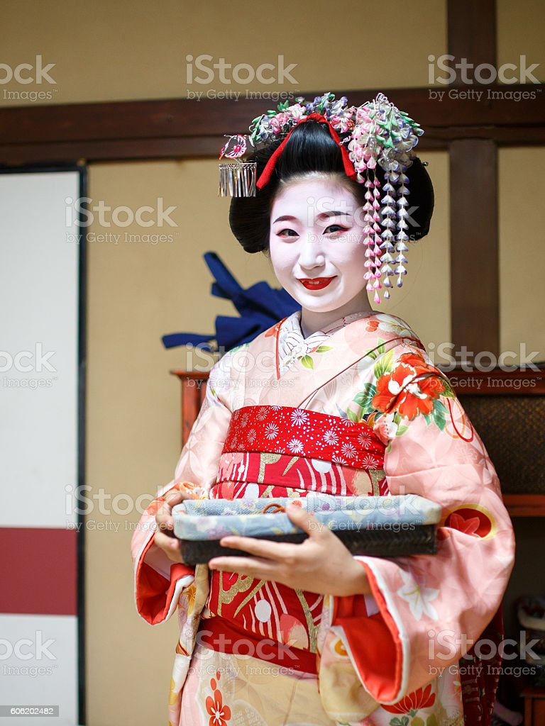 Portait of Maiko girl standing in Japanese tatami room stock photo