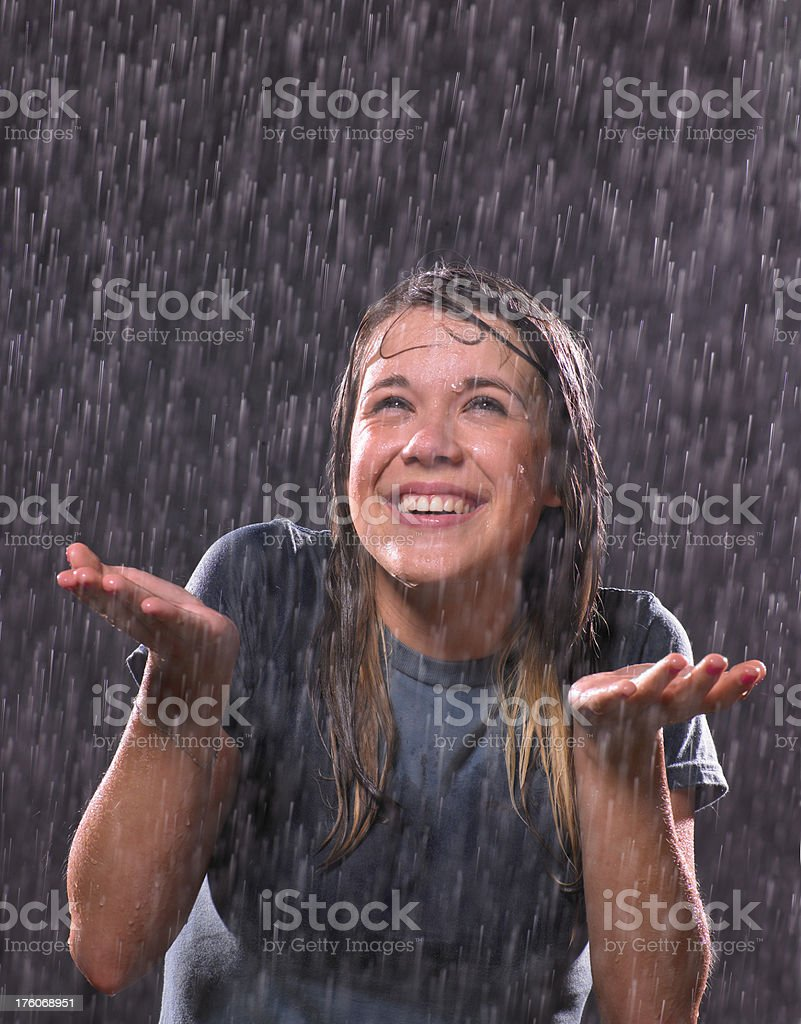 Portait of teenage girl in a rain stock photo