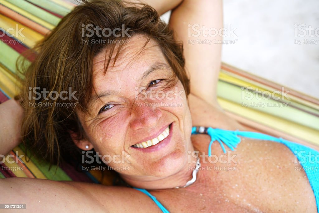 Portait of woman laying on hammock on Island  Naranjo Chico  in Caribbean See stock photo