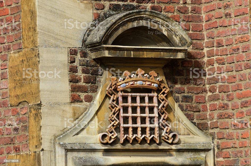 Portcullis symbol and Brick Wall stock photo