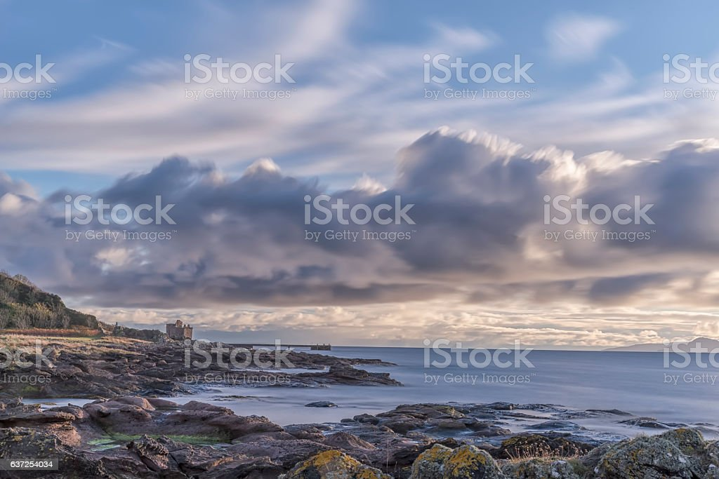 Portencross Castle, Old Pier and Rocky Foreshore. stock photo